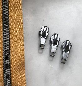 1m metallic rits aan de meter 6mm : zonnegeel met nikkel (incl. 3 schuivers)