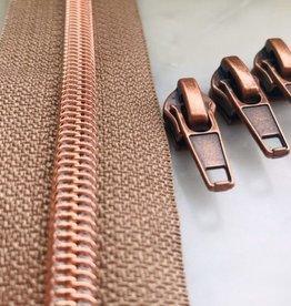 1m metallic rits aan de meter 6mm : mokka met roségoud (incl. 3 schuivers)