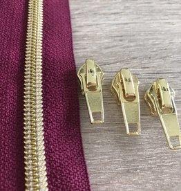 1m metallic rits aan de meter 6mm : donkermauve met goud(incl. 3 schuivers)