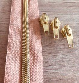 1m metallic rits aan de meter 6mm : licht oudroze met goud(incl. 3 schuivers)