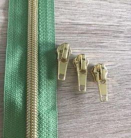 1m metallic rits aan de meter 6mm : bladgroen met goud (incl. 3 schuivers)
