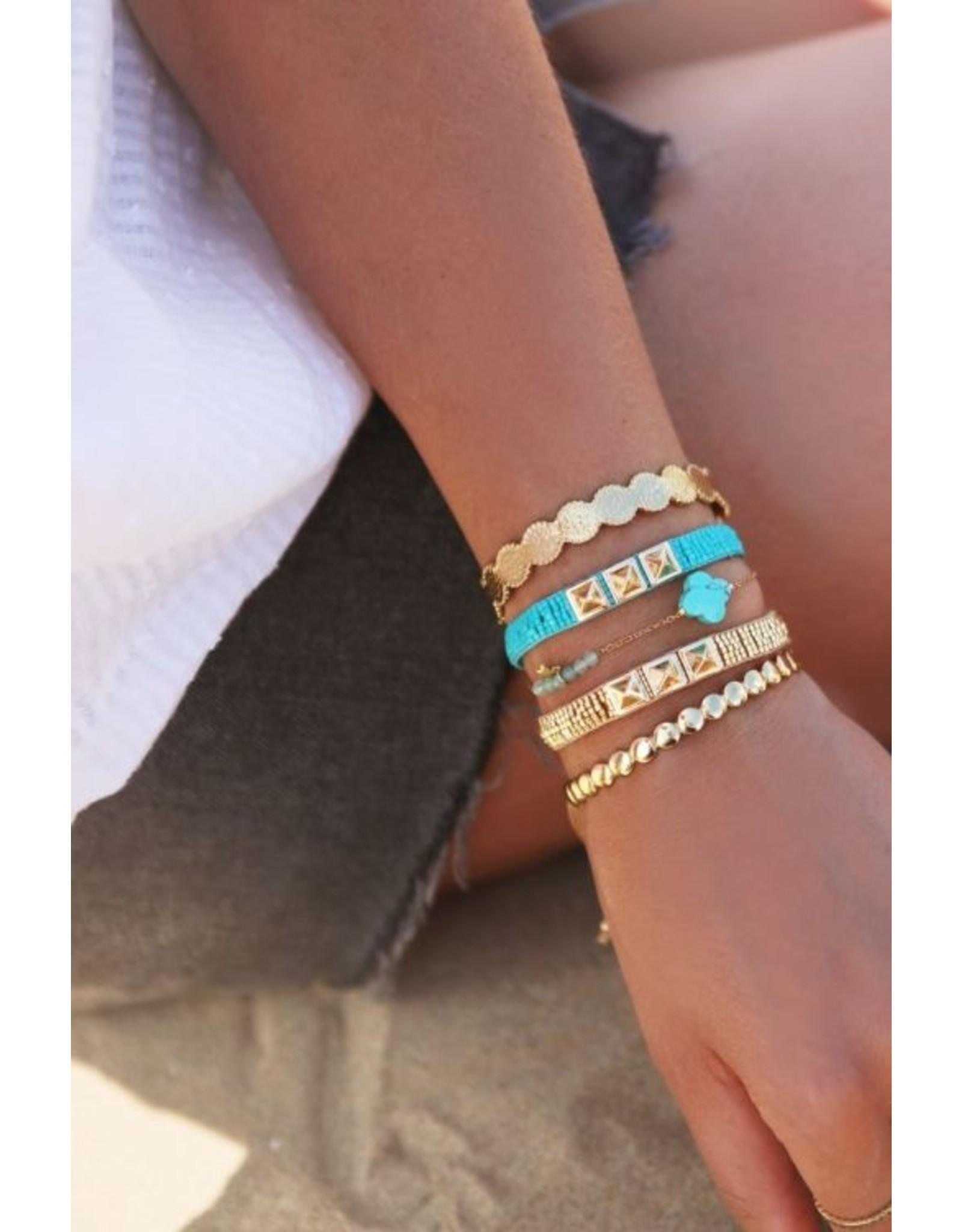 Vaste armband kleine bolletjes goud
