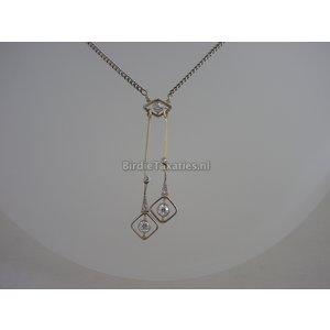 Zilveren collier met gouden Art Deco hanger bezet met oud slijpsel diamanten