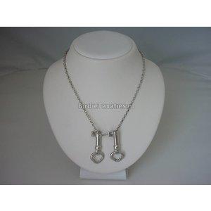 Antieke zilveren breipenhouders in de vorm van sleutels