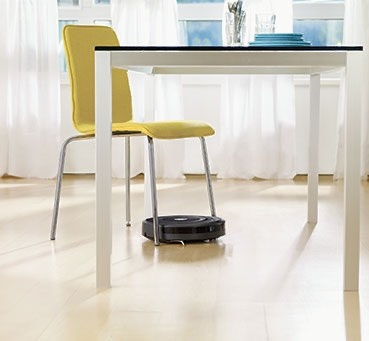 Roomba manoeuvres under a chair