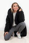 Fluffy coat met capuchon zwart