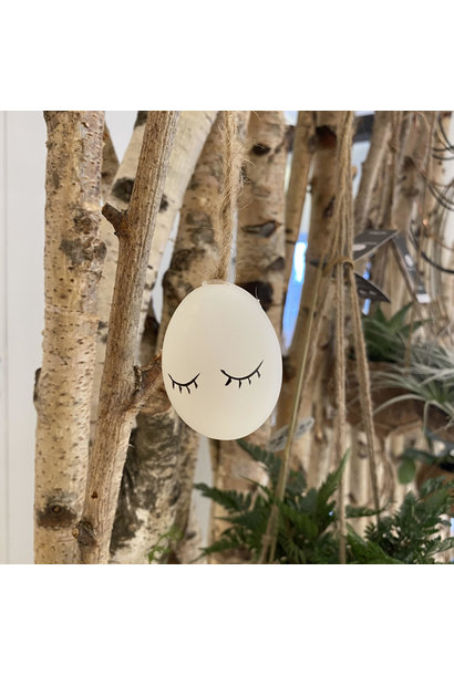 White Easter egg with face