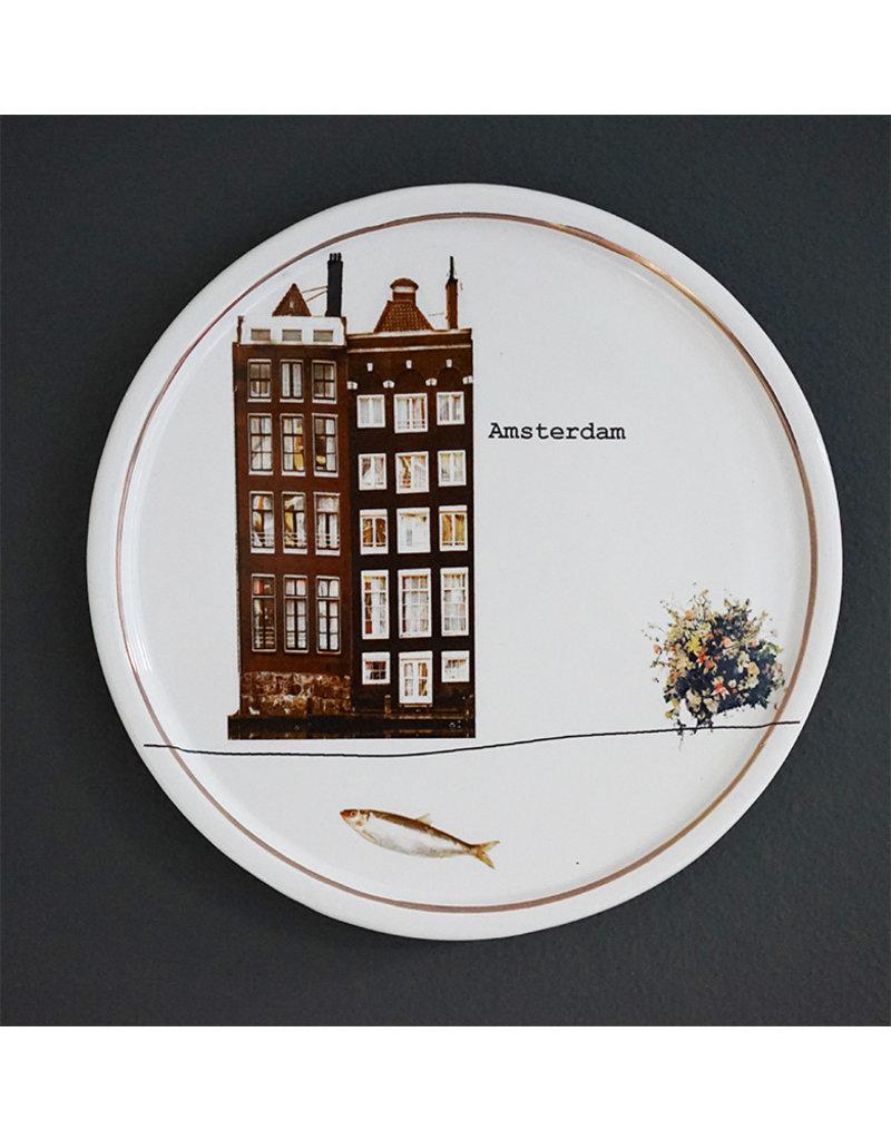 Keramieken bordje met print: Als een vis in het water
