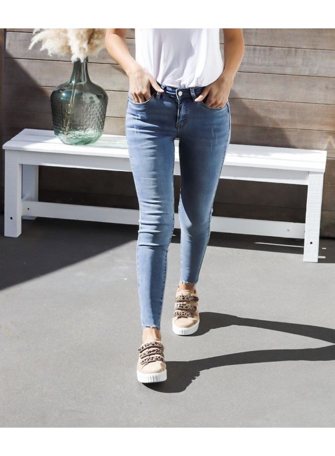 Skinny jeans distressed