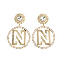 NIKKIE Pixie Earrings
