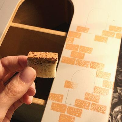 Bakstenen stempelen op DIY pakhuis