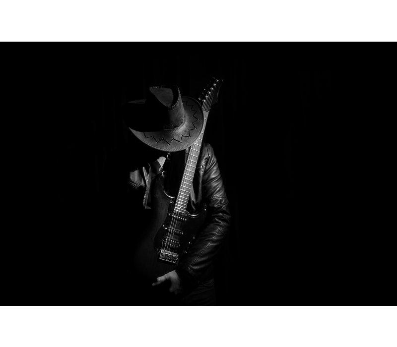 Guitarist in the dark
