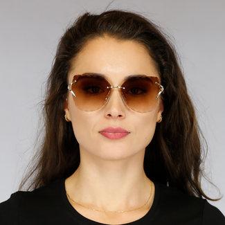 NEW1905 Sonnenbrille mit Golddetails und Inge Muster Works