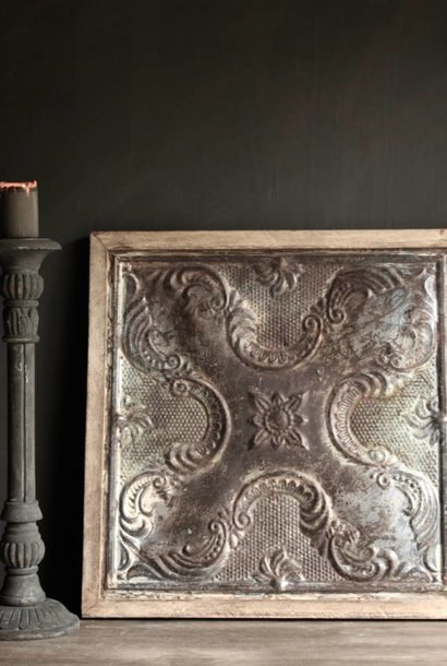 Beautiful old iron ceiling wall panel framed in wooden frame