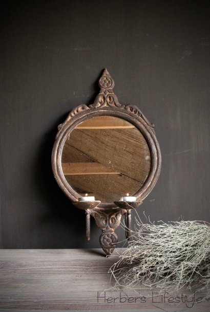 Iron mirror with two candlesticks
