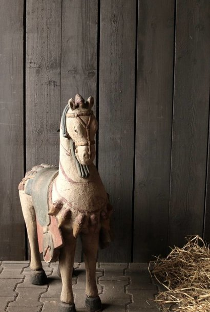 Large wooden horse in gray colors