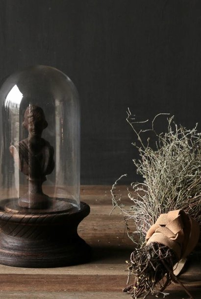 Cute little bell on a brown wooden base