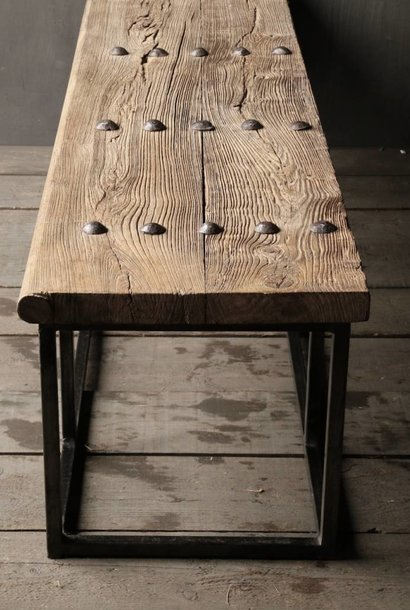 Old wooden coffee table with iron base made of an old Indian door