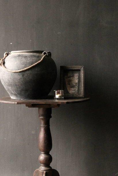 Dark wooden wine table with round leaf