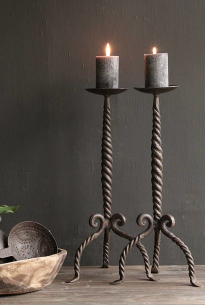 Iron candlestick with twisted paw