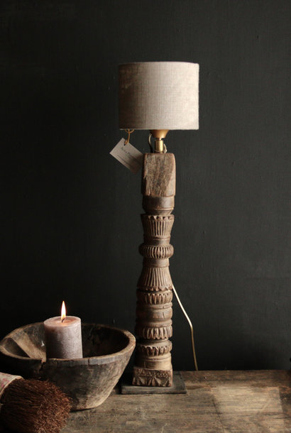 Table lamp of old wooden ornament on an iron base