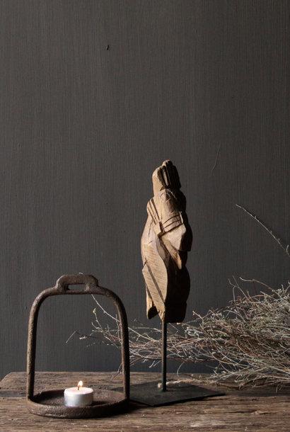 Beautiful wooden horse on iron standard