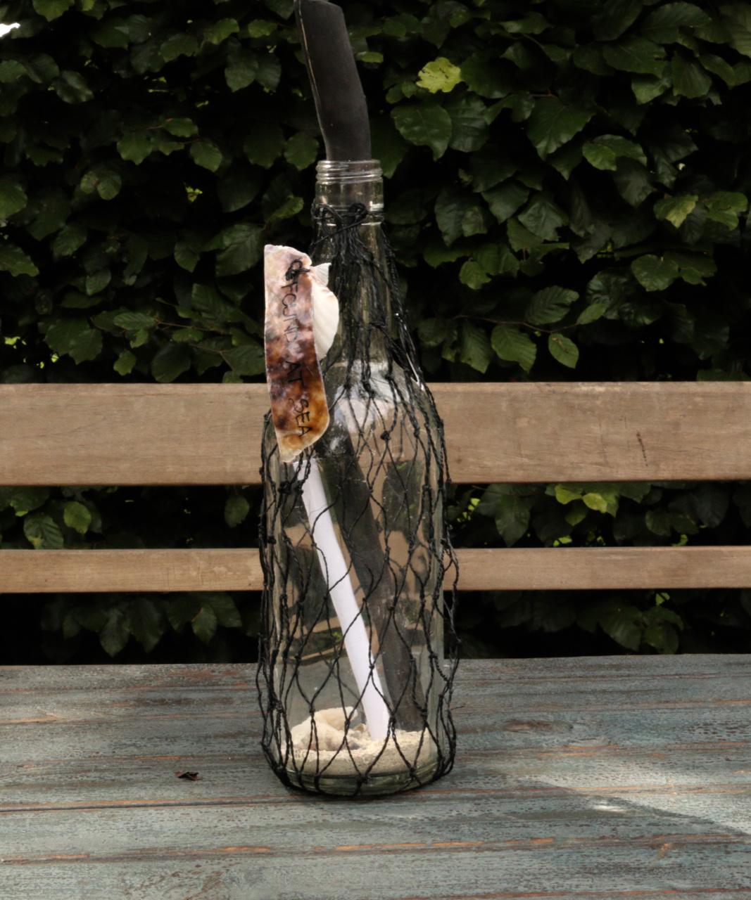 Bottle post bottle in net tied with a shell-4
