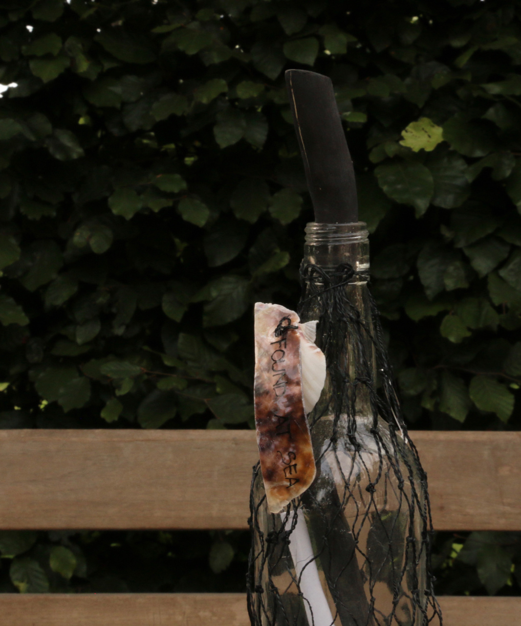 Bottle post bottle in net tied with a shell-3
