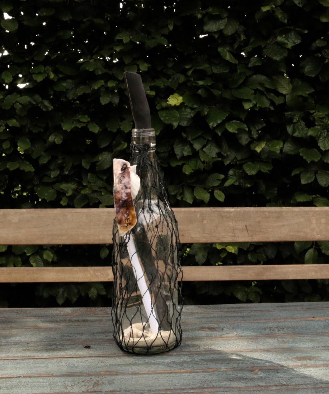 Bottle post bottle in net tied with a shell-1