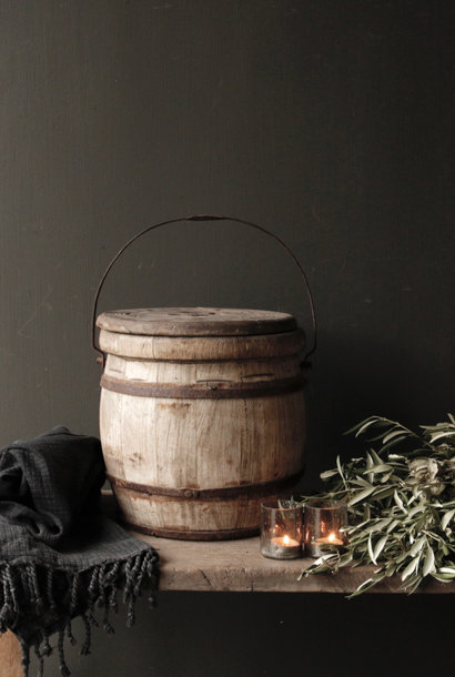 Authentic old wooden bucket with lid
