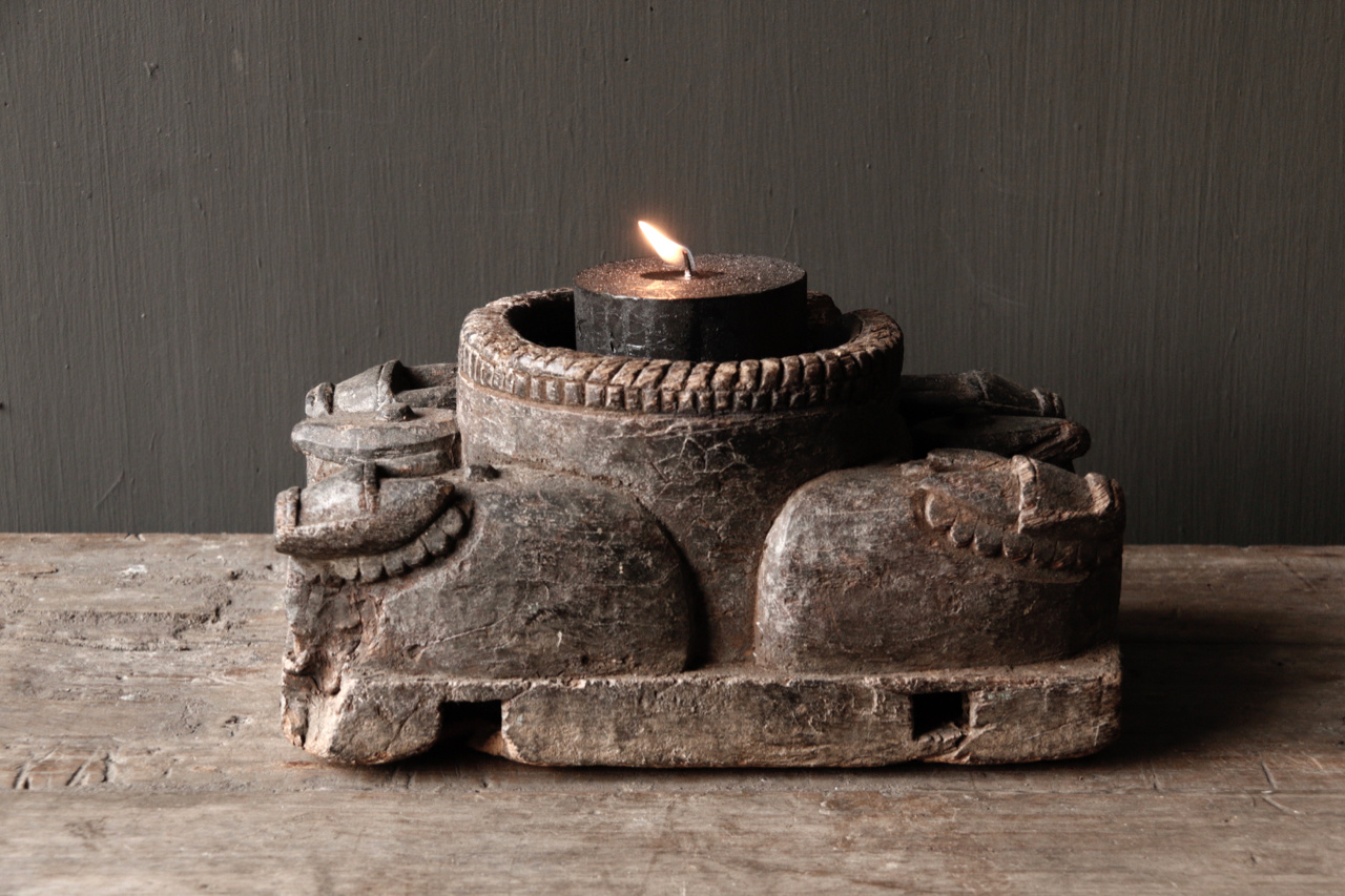Old Wooden Candlestick from ancient ornament with carved sacred cows-5