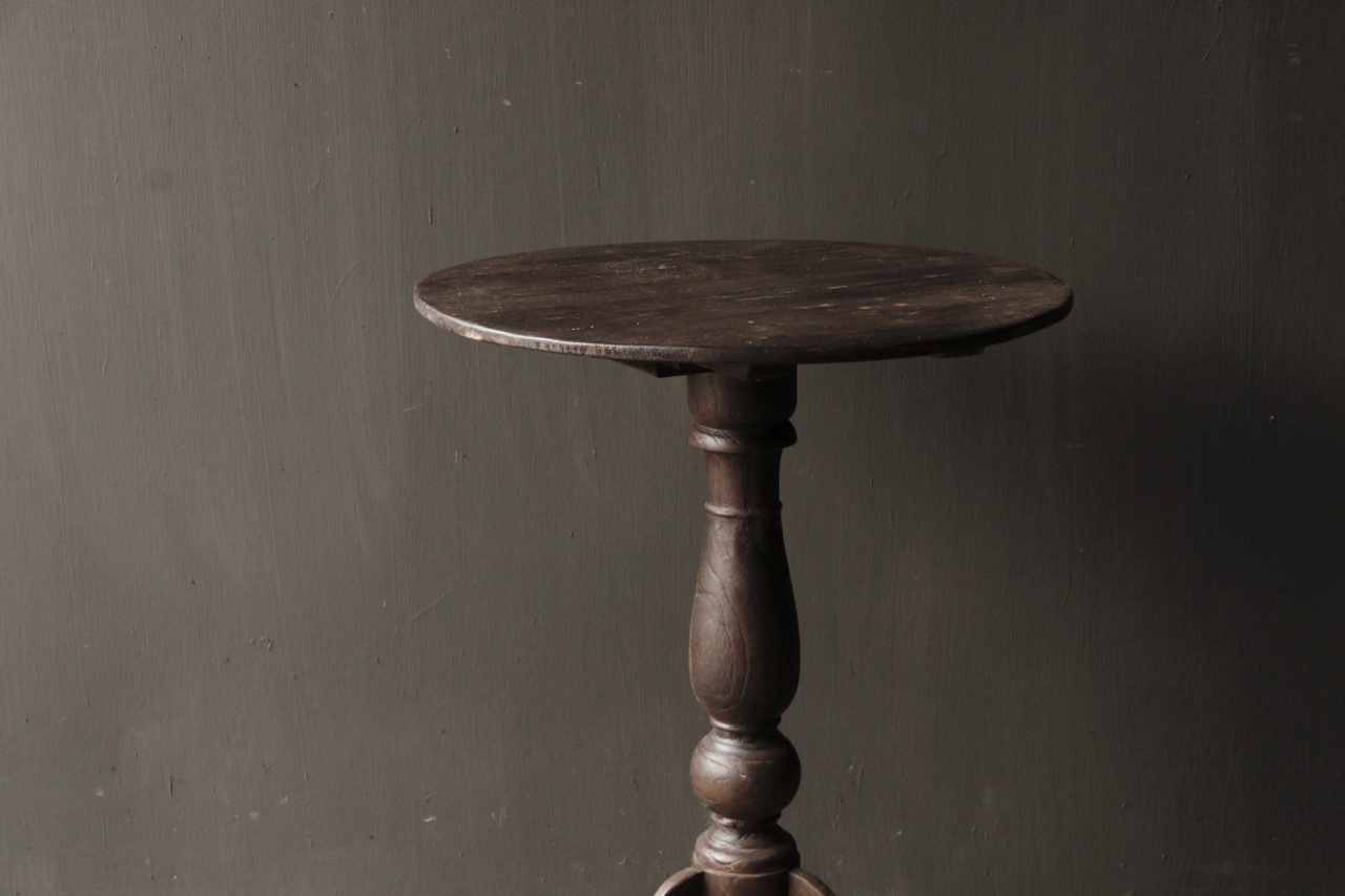 Dark wooden wine table with round top-3
