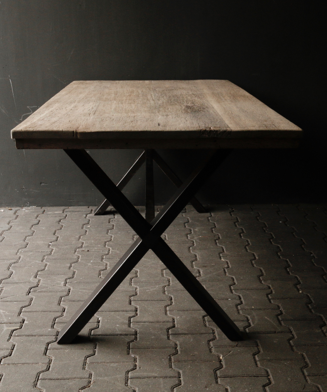 Aged brushed dining room table made of old wood with an iron cross frame-2