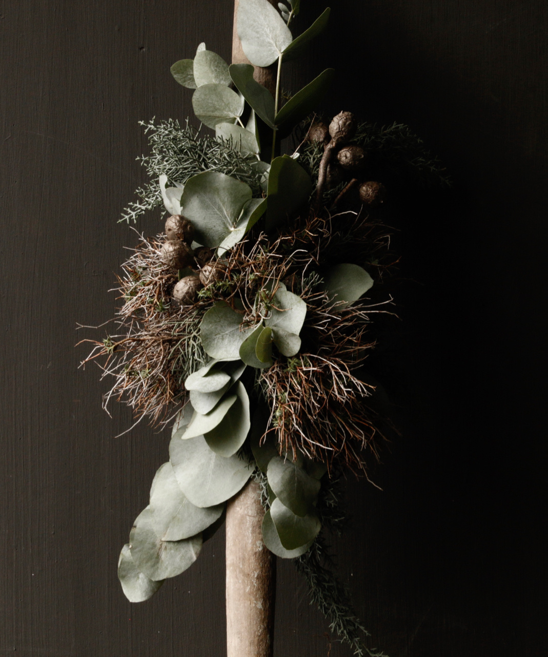 Christmas greenery tied on old wooden Indian stair arrow-5