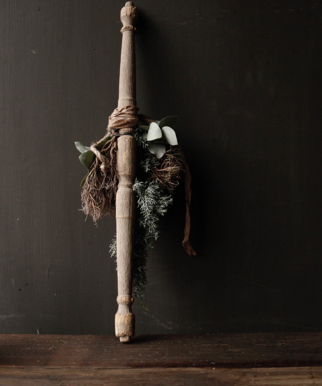 Christmas greenery tied on old wooden Indian stair arrow - Copy-4