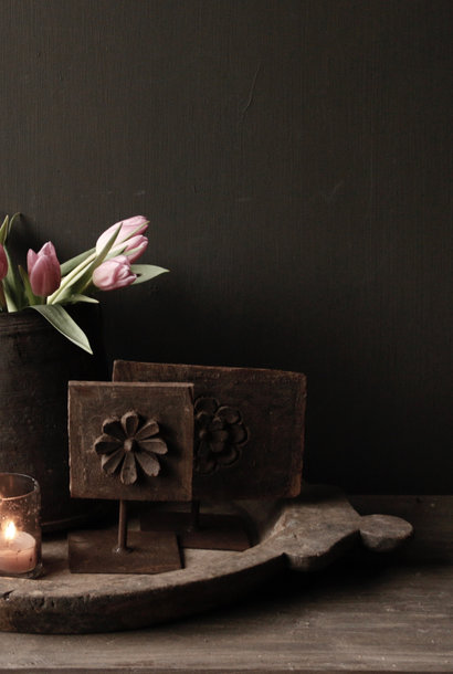 Wooden flower ornament on an iron stand