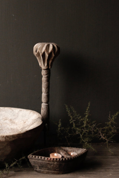 Old wooden Nepalese pestle on iron base