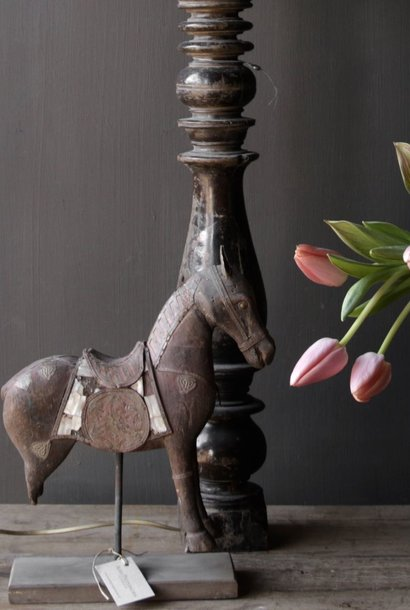 Beautiful old wooden horse on wooden tripod