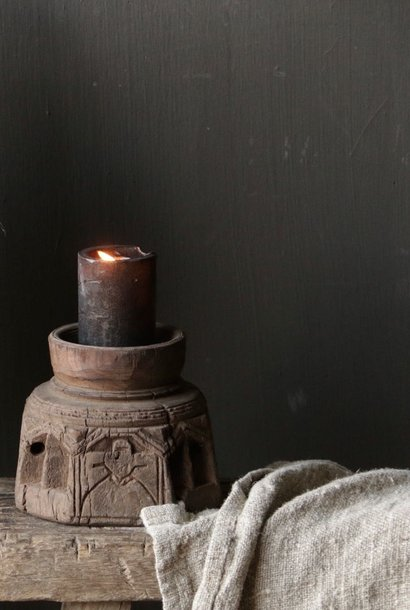 Old wooden mortar candlestick