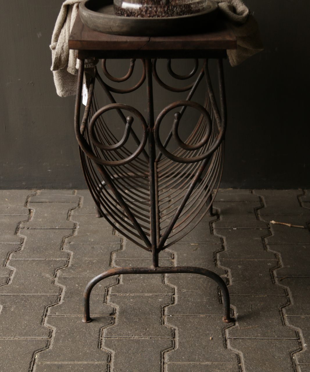 Old iron magazine rack with wooden top-3