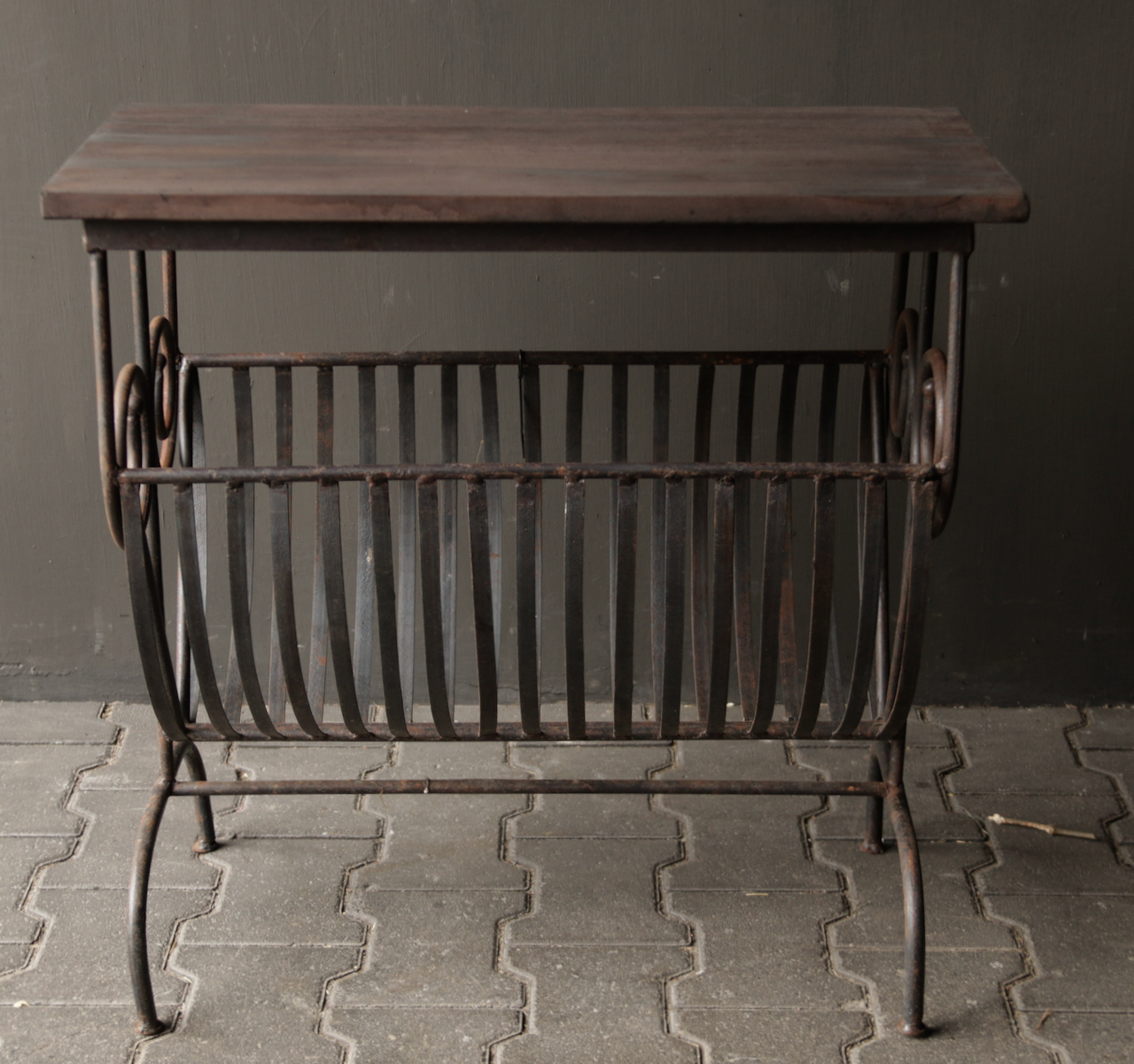 Old iron magazine rack with wooden top-9