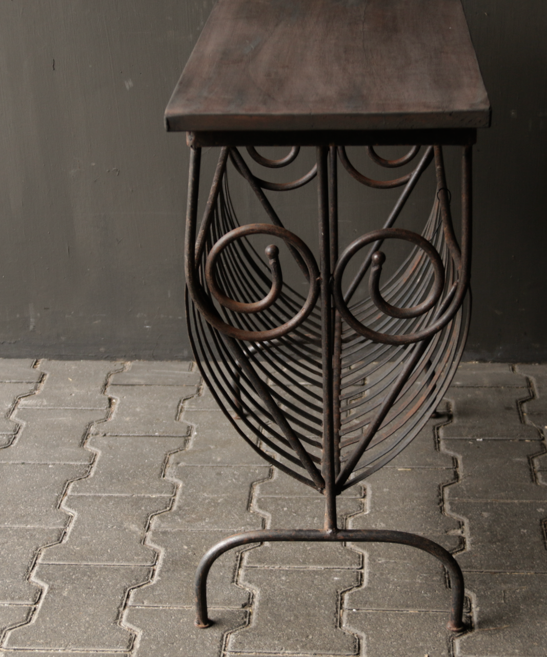 Old iron magazine rack with wooden top-10