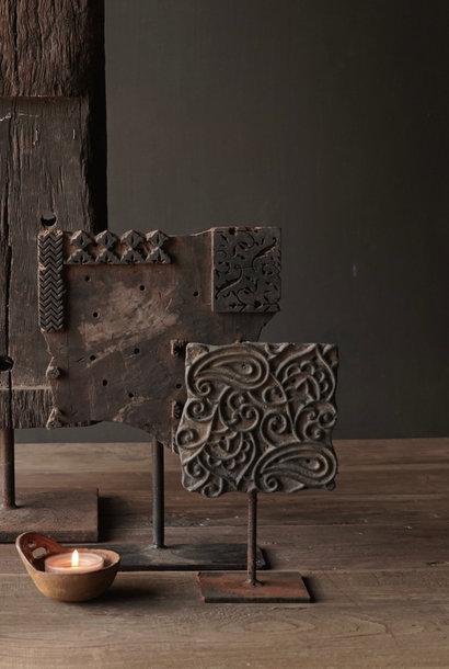 Wooden batik stamp on iron base
