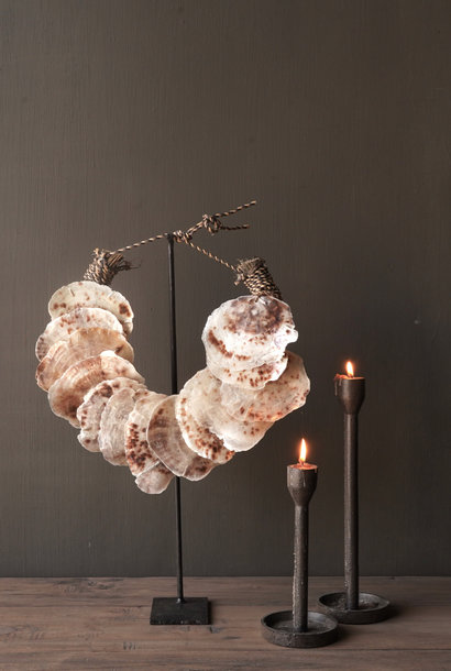 Shell necklace on iron stand