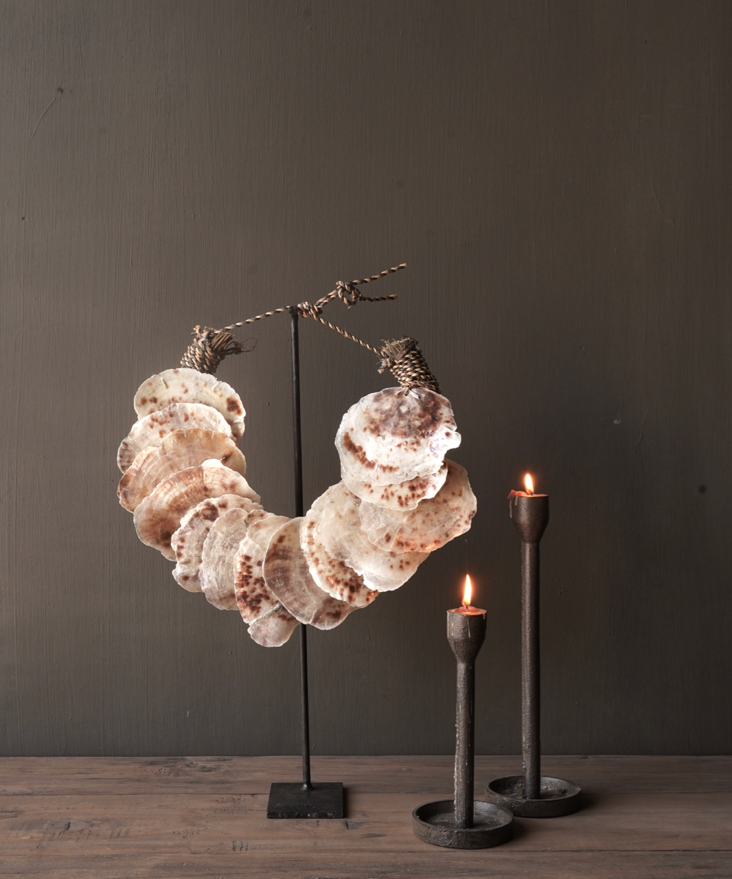 Shell necklace on iron stand-1