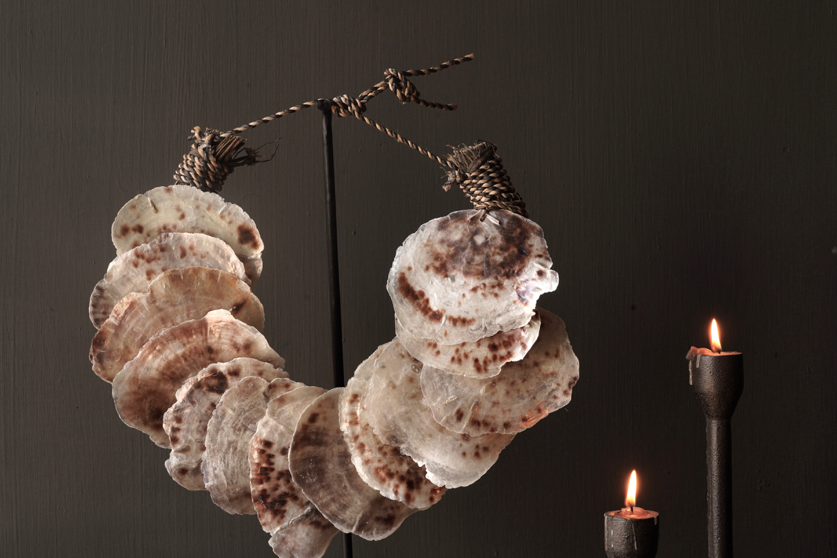 Shell necklace on iron stand-2