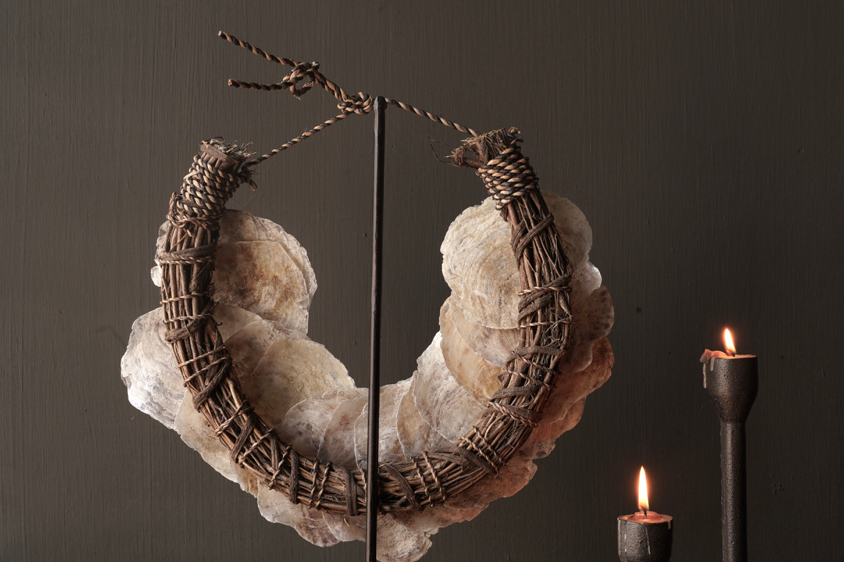 Shell necklace on iron stand-4