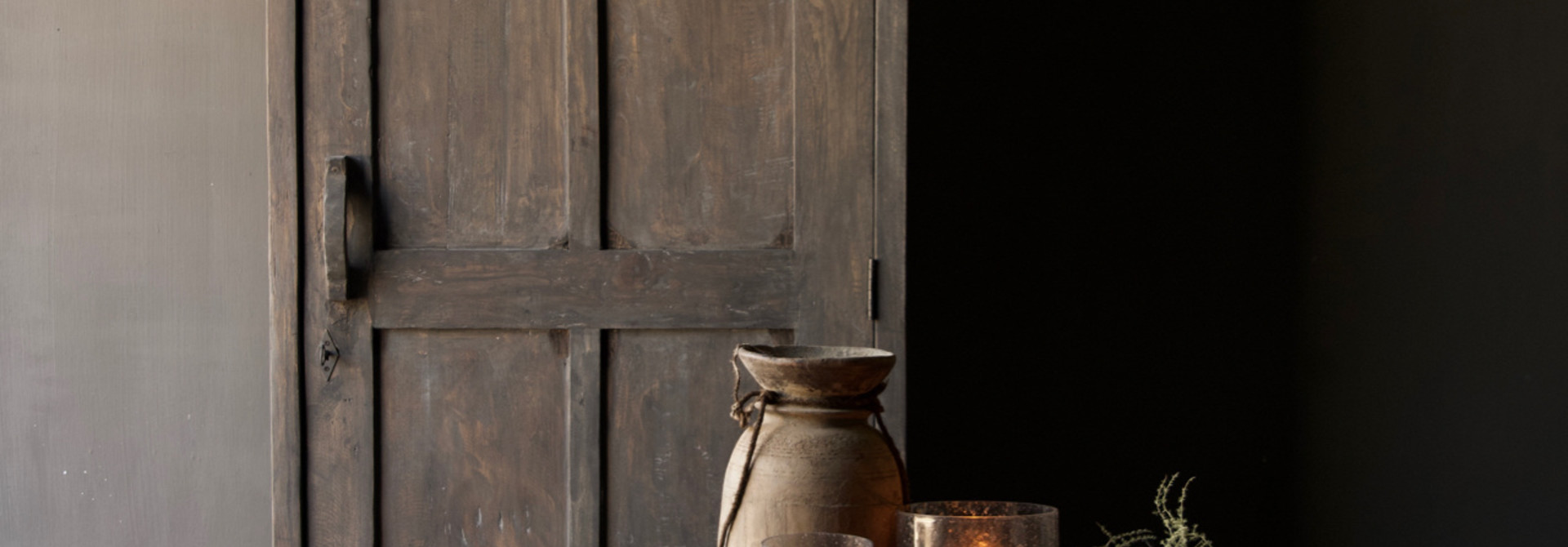 Sturdy solid door cabinet made of old wood with a drawer