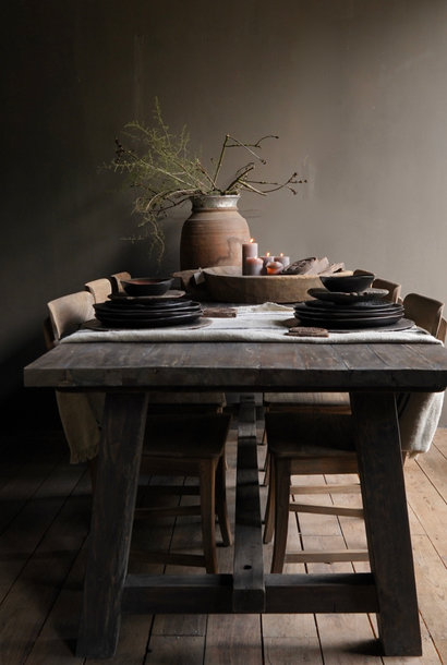 Sturdy robust rural dining room table made of old wood (stable table)
