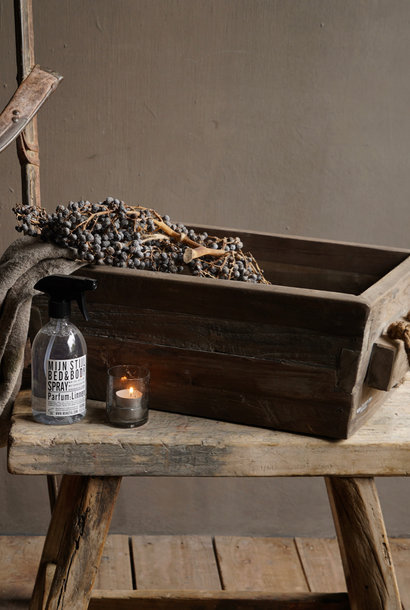 wooden trough with rope handle